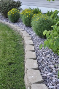 Wraparound Retaining Wall With Stone Plant Beds