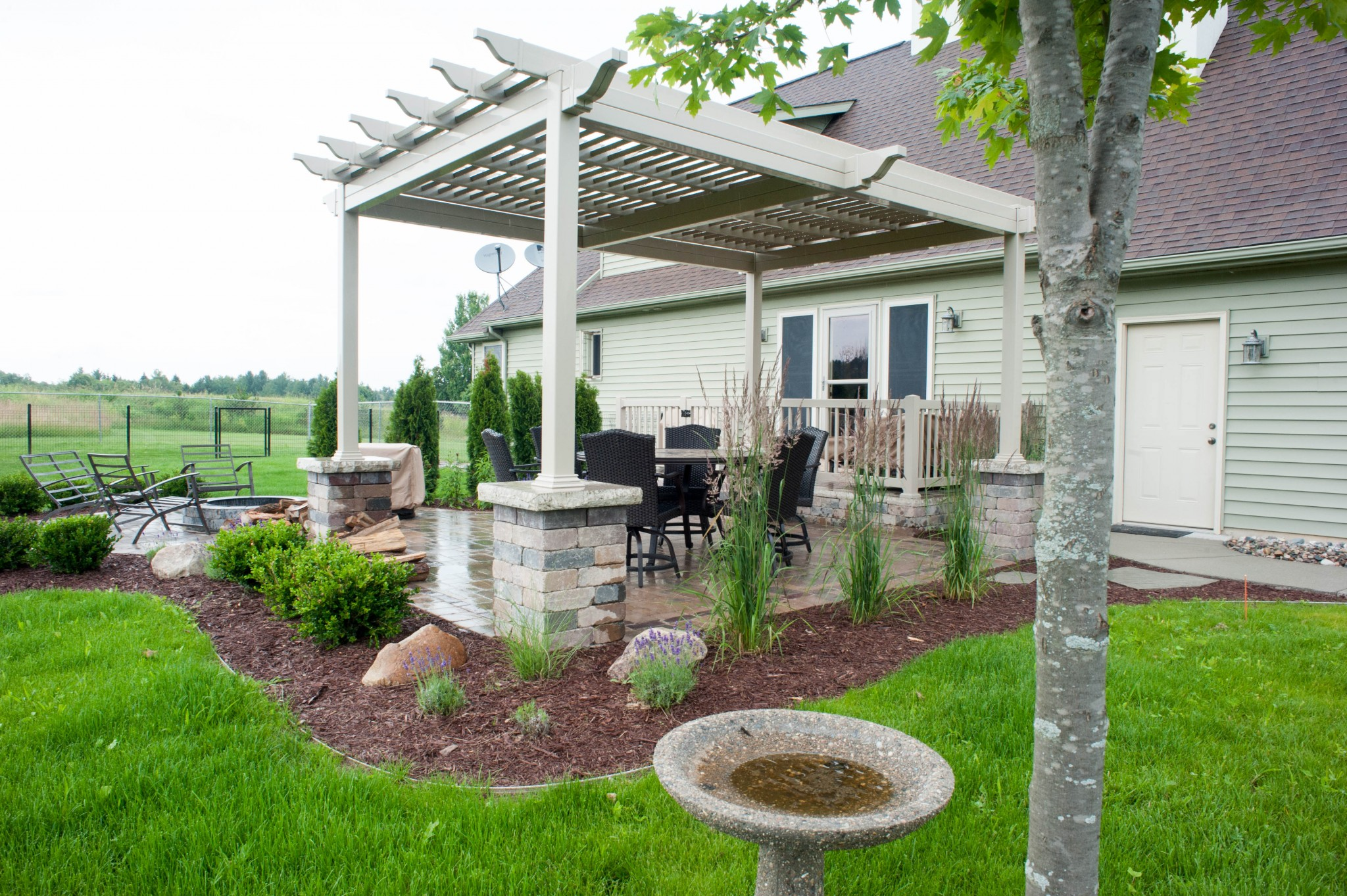 Backyard With Pergola pergola over paver patio with fire pit - r&d landscape